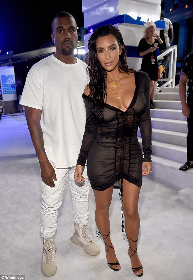 Kim Kardashian and Kanye West are together in LA after his erratic behavior prompted a psychiatric evaluation.